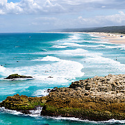 Looking south along the beach at Point Lookout on Stradbroke Island, Queensland's most easterly point. North Stradbroke Island, just off Queensland's capital city of Brisbane, is the world's second largest sand island and, with its miles of sandy beaches, a popular summer holiday destination.