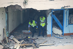 August 15, 2017 - Dhaka, Bangladesh - Police's crime scene investigators collecting evidence after a terror suspect set off a blast killing himself inside a room of the Hotel Olio International in Dhaka, Bangladesh. (Credit Image: © Suvra Kanti Das via ZUMA Wire)