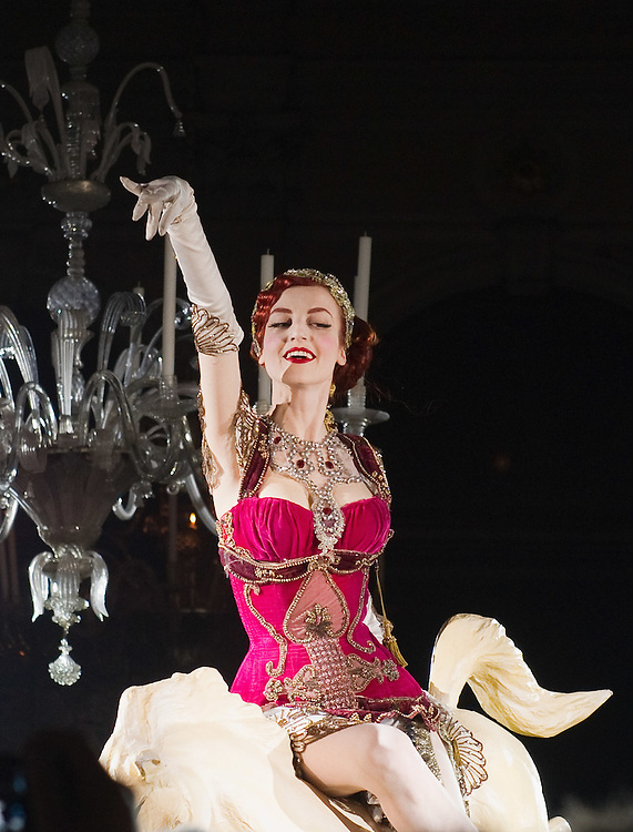 VENICE, ITALY - MARCH 05:  Burlesque dancer Eve De Plume performs at Palazzo Pisani Moretta during the annual Ballo del Doge on March 5, 2011 in Venice, Italy. The Ballo del Doge, created by fashion and costume designer Antonia Sautter, is considered the most elegant and exclusive masquerade ball during the Venice Carnival.