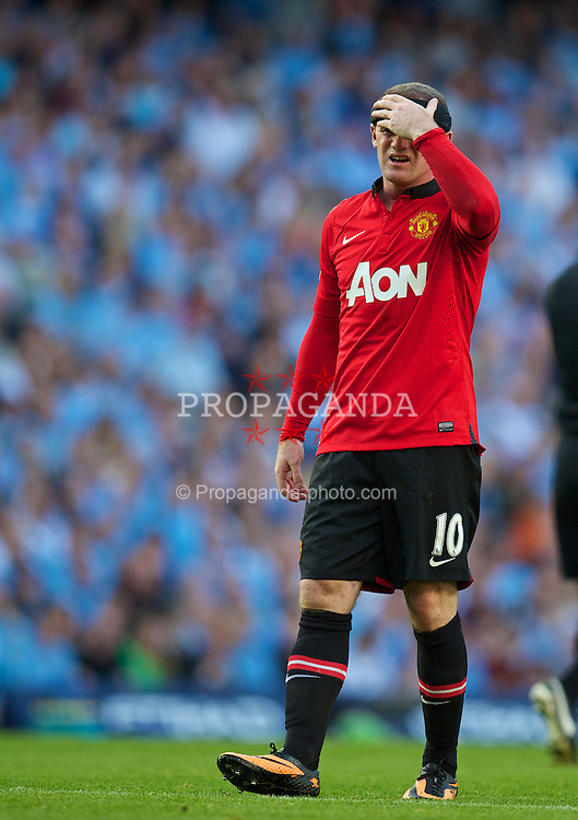 MANCHESTER, ENGLAND - Sunday, September 22, 2013: Manchester United's Wayne Rooney looks dejected as his side go 4-0 down to Manchester City during the Premiership match at the City of Manchester Stadium. (Pic by David Rawcliffe/Propaganda)