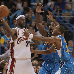 01 November 2008: Cleveland Cavaliers forward LeBron James (23) is defended by Hilton Armstrong (12) and Rasual Butler (45) during a 104-92 win by the New Orleans Hornets over the Cleveland Cavaliers at the New Orleans Arena in New Orleans, LA..