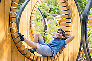 UNITED KINGDOM, London: 16 May 2019 <br /> Raphael Zaman, aged 8, relaxes in Royal Botanical Gardens Kew new Children's Garden which officially opens on the 18th of May 2019. The impressive and colourful space covers 10,000 square metres and is designed around the elements that plants need to survive.<br /> Rick Findler / Story Picture Agency