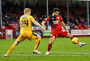 Ross Jenkins of Crawley Town takes the ball down on the edge of the box, but is quickly closed down by Conor Newton of Cambridge United during the Sky Bet League 2 match between Crawley Town and Cambridge United at the Checkatrade.com Stadium, Crawley, England on 9 January 2016. Photo by Andy Walter.
