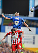 Jayden Stockley beats Adam Buxton to the ball during the Sky Bet League 2 match between Portsmouth and Accrington Stanley at Fratton Park, Portsmouth, England on 5 September 2015. Photo by Adam Rivers.
