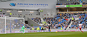 Brighton's Goalkeeper David Stockdale saves from Birmingham City's Paul Caddis during the Sky Bet Championship match between Brighton and Hove Albion and Birmingham City at the American Express Community Stadium, Brighton and Hove, England on 21 February 2015. Photo by Phil Duncan.