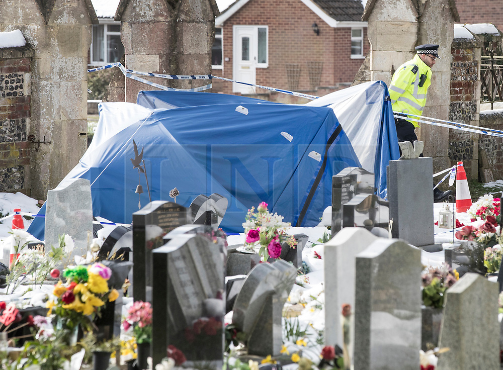© Licensed to London News Pictures. 20/03/2018. Salisbury, UK. A police evidence tent covers the grave of Alexander Skripal, son of former Russian spy Sergei Skripal, in the cemetery in Salisbury. Former Russian spy Sergei Skripal, his daughter Yulia are still critically ill after being poisoned with nerve agent. The couple where found unconscious on bench in Salisbury shopping centre. Authorities continue to investigate. Photo credit: Peter Macdiarmid/LNP
