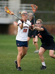 Virginia Cavaliers A Megan O'Malley (28) passes around Princeton Tigers M Holly McGarvie (7).  The Virginia Cavaliers women's lacrosse team defeated the Princeton Tigers 9-7 at Klockner Stadium in Charlottesville, VA on March 24, 2007.
