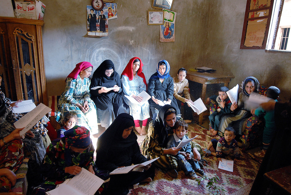 <b>Photograph by Claudia Wiens:</b><br>EGYPT, DEIR AL BARSHA: Deir al Barsha is a tiny, very poor village in middle Egypt. This women are beneficaries of micro credits. In order to be able to run their enterprises they attend a literacy class, in which they also learn the basics of math.