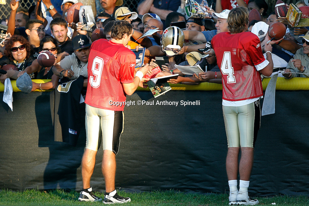 New Orleans Saints quarterback Drew Brees (9) and Saints quarterback Sean Canfield (4) sign fan autographs during the Saints west coast NFL training camp on Wednesday, August 24, 2011 in Oxnard, California. (©Paul Anthony Spinelli)