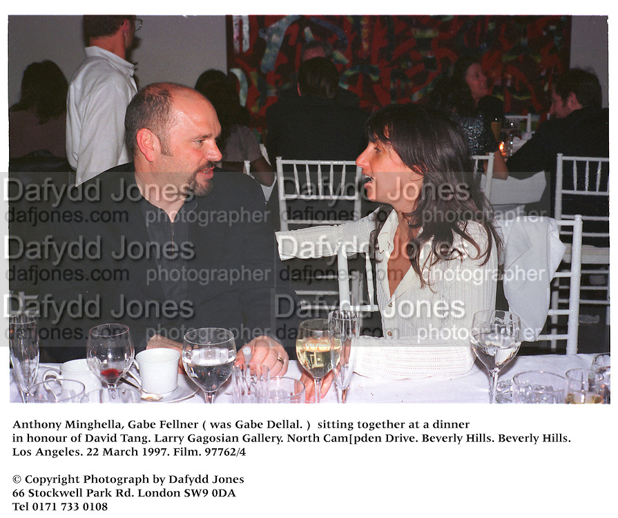 Anthony Minghella, Gabe Fellner ( was Gabe Dellal. )  sitting together at a dinner in honour of David Tang. Larry Gagosian Gallery. North Cam[pden Drive. Beverly Hills. Beverly Hills.Los Angeles. 22 March 1997. Film.97762/4<br />