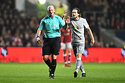 Referee Mike Dean with Daley Blind (17) of Manchester United during the EFL Cup match between Bristol City and Manchester United at Ashton Gate, Bristol, England on 20 December 2017. Photo by Graham Hunt.