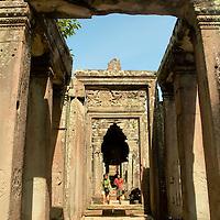 Tourists walking at one of the ruins at Angkor
