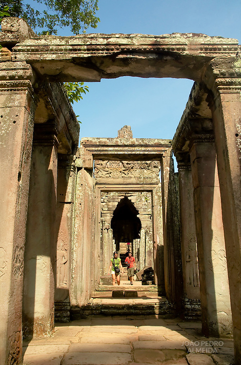 Tourists walking at one of the ruins at Angkor