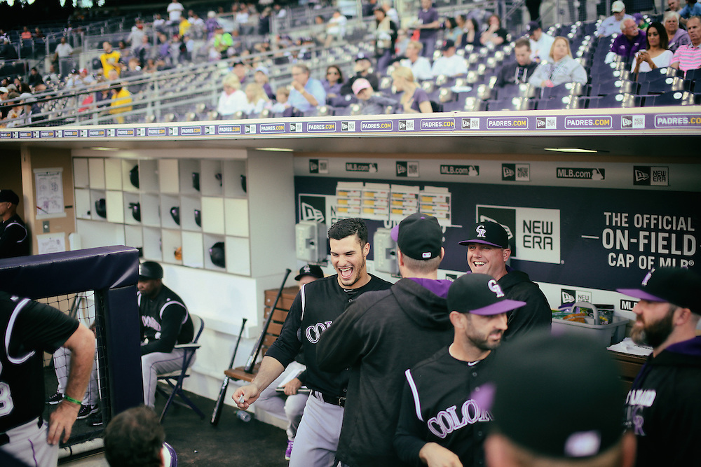 San Diego, CA - JUNE 04:   Nolan Arenado shares a laugh with teammates in the dugout at Petco Park during game with the San Diego Padres San Diego, California.  (Sandy Huffaker for ESPN)
