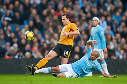 MANCHESTER, ENGLAND - Saturday, November 28, 2009: Manchester City's Nigel De Jong and Hull City's Richard Garcia during the Premiership match at the City of Manchester Stadium. (Photo by David Rawcliffe/Propaganda)