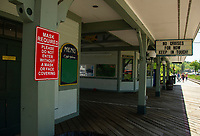 Signage at the Weirs Beach Boardwalk bearing the restrictions due to the Coronavirus pandemic.  (Karen Bobotas/for the Laconia Daily Sun)