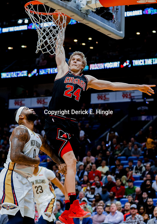 Jan 22, 2018; New Orleans, LA, USA; Chicago Bulls forward Lauri Markkanen (24) dunks over New Orleans Pelicans center DeMarcus Cousins (0) during the first quarter at  the Smoothie King Center. Mandatory Credit: Derick E. Hingle-USA TODAY Sports