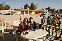 eating oysters with daryll worley in mosul, Iraq - Photograph by Owen Franken
