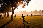 30th October 2015, New Delhi, India. Men play cricket in the early morning next to Raj Path near India Gate in New Delhi, India on the 30th October 2015<br /> <br /> PHOTOGRAPH BY AND COPYRIGHT OF SIMON DE TREY-WHITE<br /> <br /> + 91 98103 99809<br /> email: simon@simondetreywhite.com<br /> photographer in delhi