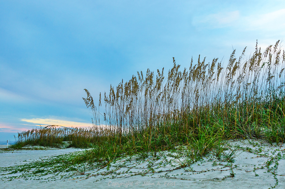 "I've always liked this shot.  While it's nothing ""special"" it always gives me a feeling of calm and peace to view the grass growing out of the dunes."