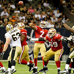 August 12, 2011; New Orleans, LA, USA; San Francisco 49ers quarterback Colin Kaepernick (7) throws against the New Orleans Saints during the second half of a preseason game at the Louisiana Superdome. The New Orleans Saints defeated the San Francisco 49ers Mandatory Credit: Derick E. Hingle
