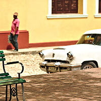 Iconic, old parked car at a back street of Trinidad