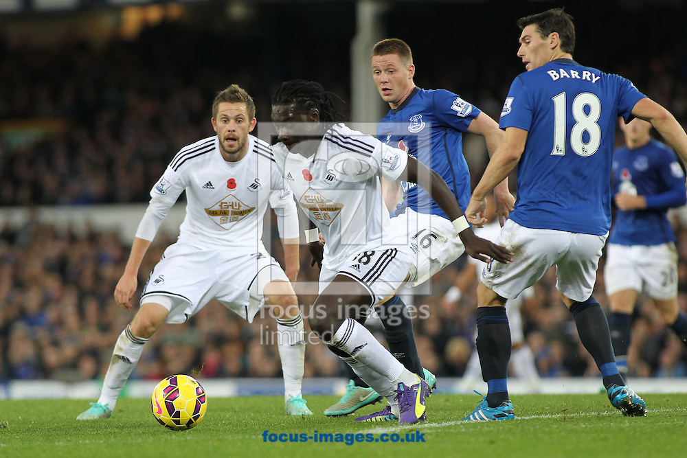 Bafetimbi Gomis of Swansea City attempts to break through the Everton defence during the Barclays Premier League match at Goodison Park, Liverpool.<br /> Picture by Michael Sedgwick/Focus Images Ltd +44 7900 363072<br /> 01/11/2014
