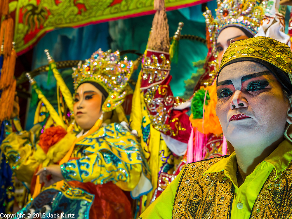 16 JANUARY 2015 - BANGKOK, THAILAND:  The Sai Yong Hong Opera Troupe performs at the Chaomae Thapthim Shrine, a Chinese shrine in a working class neighborhood of Bangkok near the Chulalongkorn University campus. The troupe's nine night performance at the shrine is an annual tradition and is the start of the Lunar New Year celebrations in the neighborhood. Lunar New Year, also called Chinese New Year, is officially February 19 this year. Teochew opera is a form of Chinese opera that is popular in Thailand and Malaysia.   PHOTO BY JACK KURTZ