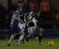 Photo: Olly Greenwood.<br />Colchester United v Hull City. Coca Cola Championship. 28/11/2006. Hull's John Welsh goes past Colchester's Kevin McLeod