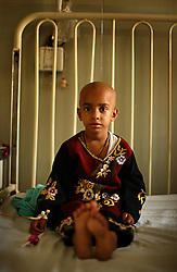 Nabila, 5, is treated for cancer and stones in her stomach inside the Children's Hospital at the Pakistan Institute of Medical Sciences, P.I.M.S., in Islamabad, Pakistan on Sept. 19, 2007.