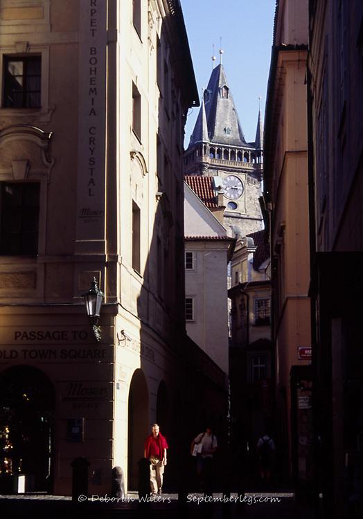 Man walking in narrow cobbled street leading away from Old Town Square, Staromestske Namesti, Prague, Czech Republic