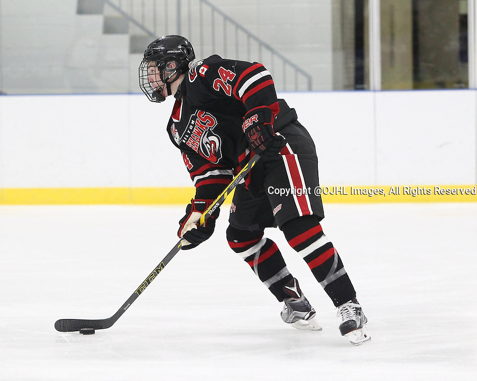 MILTON, ON - Oct 23, 2015 : Ontario Junior Hockey League game action between Kingston and Milton. Troy Taylor #24 of the Milton Ice Hawks skates with the puck during the second period.<br /> (Photo by Tim Bates / OJHL Images)