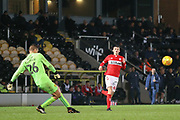 Dimitar Evtimov of Burton Albion (26) clears from Dan Ward of Middlesbrough (35) during the EFL Trophy group stage match between Burton Albion and U21 Middlesbrough at the Pirelli Stadium, Burton upon Trent, England on 7 November 2018.