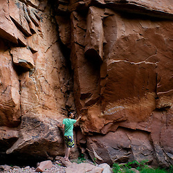 Jeff Olson explores the sandstone cliffs of Nutria Canyon on the Zuni Indian Reservation in northwest New Mexico,