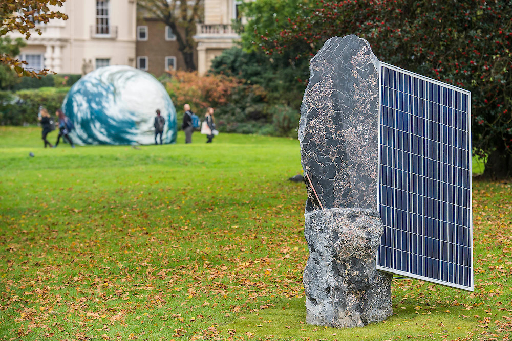 Haroon Mirza collaboration with Mattia Bosco Standing Stones<br /> (Solar Symphony 8), 2015 Lisson Gallery and Seung-taek Lee, Earth Play, 1979–89, Gallery Hyundai - Frieze Sculpture Park London 2015, Regents Park, London. The Frieze Sculpture Park 2015 comprises 16 new and historical works, set in the English Gardens between Frieze Masters and Frieze London. Selected by Clare Lilley (Director of Programme, Yorkshire Sculpture Park) and with free public access, the Frieze Sculpture Park gives visitors to The Regent's Park a rare opportunity to encounter exceptional sculpture and installation art by international artists in the open air. Works for 2015 include: Lock (1976-7), a major installation by Richard Serra, which Peter Freeman (New York) will be shown for the first time publicly since it was exhibited at the Whitney Museum in 1976; Anri Sala's Holey Wall (Should I Stay or Should I Go) (2014-15), remade for Frieze together with live performances originally commissioned for the 12th Havana Biennial (Galerie Chantal Crousel, Paris & Marian Goodman Gallery, London); a new solar-powered sound and light work by Haroon Mirza (Lisson Gallery, London); Earth Play (1979), Seung-Taek Lee's monumental balloon model of the earth (Gallery Hyundai, Seoul); Open Screen (2014) by Carol Bove (David Zwirner, London) and an impressive 11th-14th Century AD pre-Ekoi monolith from Western Africa (Didier Claes, Brussels). The fair is open to the public 14–17 October.