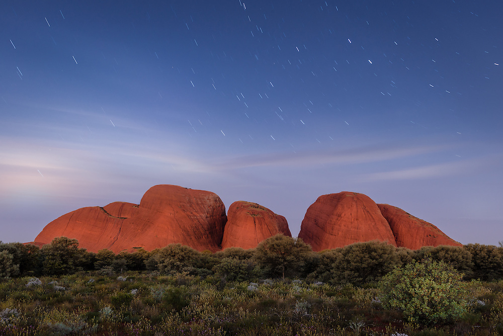 Domes of Kata Tjuta with night sky and star trails