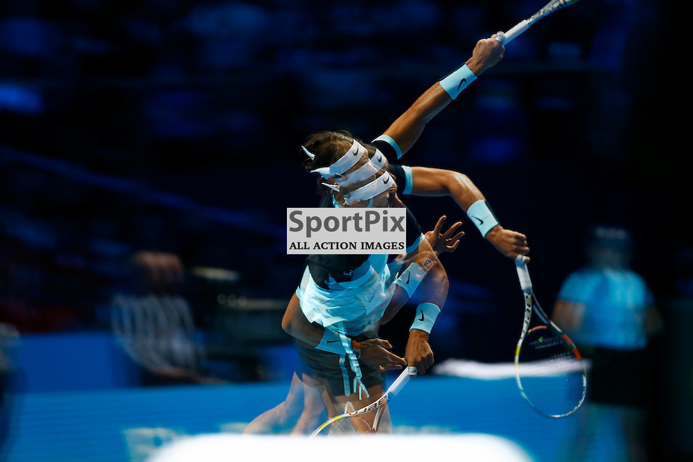 Multiple exposure of Rafael Nadal serving. ATP Finals 2015 at O2 Arena, London. Stanislas Wawrinka plays Rafael Nadal in their first match in the Group Ilie Nastase. 16th November 2015. (c) Matt Bristow | SportPix.org.uk