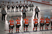The RIT Women's Hockey team listens to the Canadian and American National Anthems before an exhibition game against Pursuit of Excellence, a junior team from British Columbia, at RIT's Gene Polisseni Center on Monday, September 29, 2014.