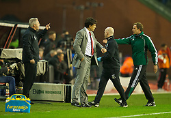 BRUSSELS, BELGIUM - Tuesday, October 15, 2013: Wales' coach Kit Symons argues with the fourth official during the 2014 FIFA World Cup Brazil Qualifying Group A match against Belgium at the Koning Boudewijnstadion. (Pic by David Rawcliffe/Propaganda)