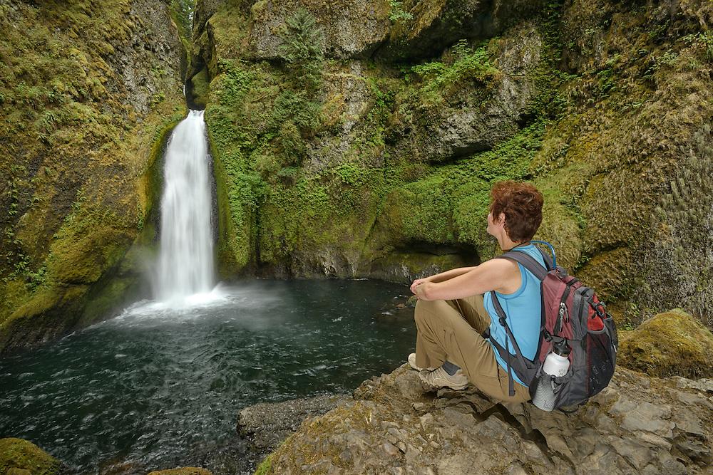Hiker at Wahclella Falls,Columbia River Gorge National Scenic  Area,Multnomah County,Oregon, USA<br /> Model releae 0009