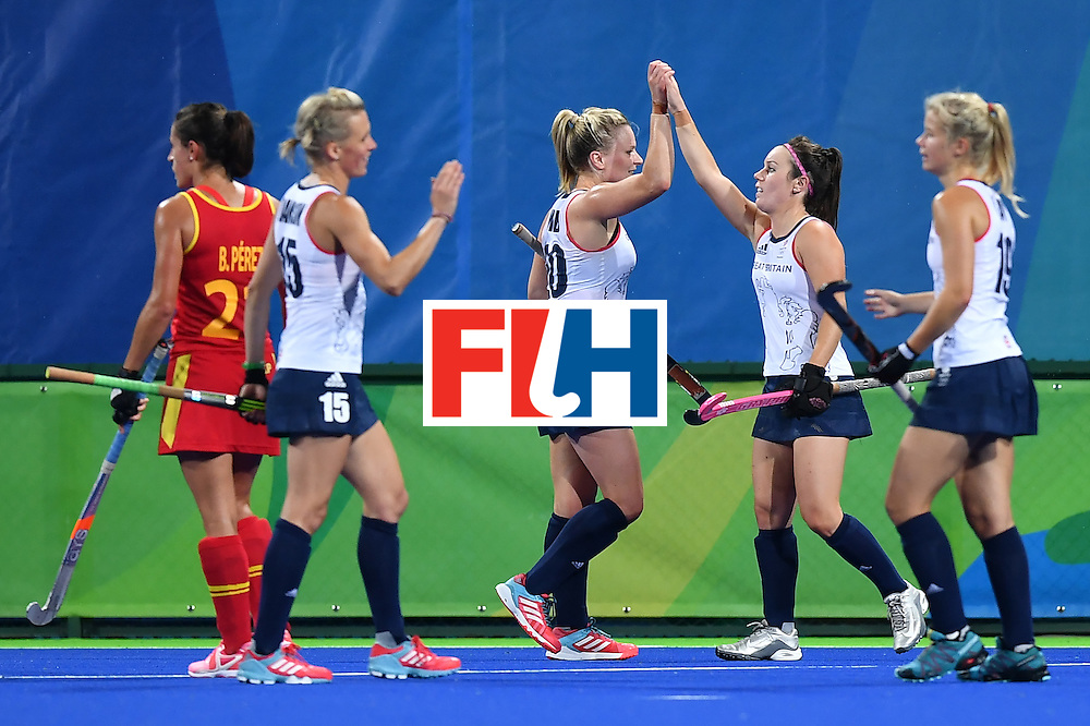 Britain's players celebrate after the women's quarterfinal field hockey Britain vs Spain match of the Rio 2016 Olympics Games at the Olympic Hockey Centre in Rio de Janeiro on August 15, 2016. / AFP / MANAN VATSYAYANA        (Photo credit should read MANAN VATSYAYANA/AFP/Getty Images)