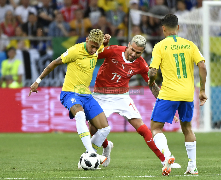 ROSTOV-ON-DON, June 17, 2018  Valon Behrami (C) of Switzerland vies with Neymar (L) of Brazil during a group E match between Brazil and Switzerland at the 2018 FIFA World Cup in Rostov-on-Don, Russia, June 17, 2018. The match ended in a 1-1 draw. (Credit Image: © Chen Yichen/Xinhua via ZUMA Wire)
