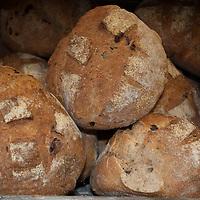 Loaves of crusty whole grain bread.