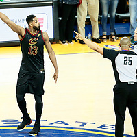 OAKLAND, CA - MAY 31: Tristan Thompson #13 of the Cleveland Cavaliers reacts as he is ejected by referee Tony Brothers #25 in Game One of the 2018 NBA Finals won 124-114 in OT by the Golden State Warriors over the Cleveland Cavaliers at the Oracle Arena on May 31, 2018 in Oakland, California. NOTE TO USER: User expressly acknowledges and agrees that, by downloading and or using this photograph, User is consenting to the terms and conditions of the Getty Images License Agreement. Mandatory Copyright Notice: Copyright 2018 NBAE (Photo by Chris Elise/NBAE via Getty Images)