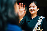 A young woman is offered a traditional greeting upon arrival at Dwarika's Hotel in Kathmandu.
