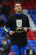 Picture by David Horn/Focus Images Ltd +44 7545 970036<br /> 26/10/2013<br /> Mesut Ozil of Arsenal wearing a t-shirt celebrating The FA 150 Years celebration before during the Barclays Premier League match at Selhurst Park, London.