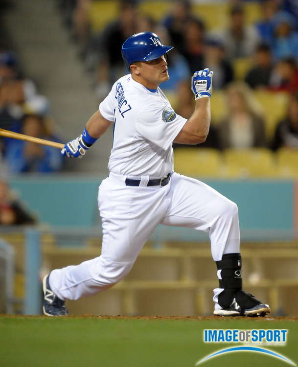Apr 3, 2012; Los Angeles, CA, USA; Los Angeles Dodgers first baseman Tim Federowicz (31) sprints toward third base on a single against the Los Angeles Angels at Dodger Stadium.