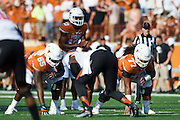 AUSTIN, TX - SEPTEMBER 26:  Jerrod Heard #13 of the Texas Longhorns reads the defense against the Oklahoma State Cowboys on September 26, 2015 at Darrell K Royal-Texas Memorial Stadium in Austin, Texas.  (Photo by Cooper Neill/Getty Images) *** Local Caption *** Jerrod Heard
