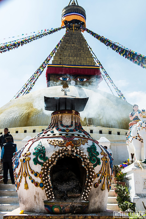 Smoke rises from burning incense from an alter in front of the Boudhanath stupa in Kathmandu, Nepal.