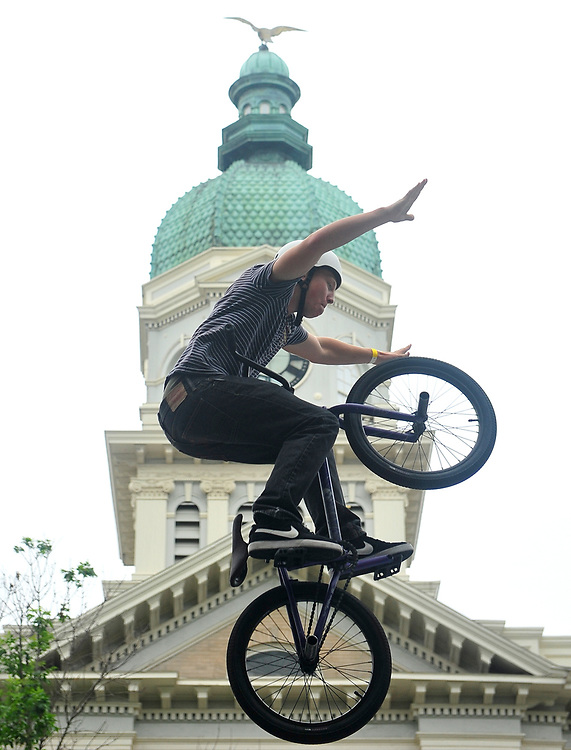 Westin Sachs goes hands free over a ramp as he competes in the Twilight BMX Jam in Downtown Athens, Ga, on Saturday, April 28, 2012.